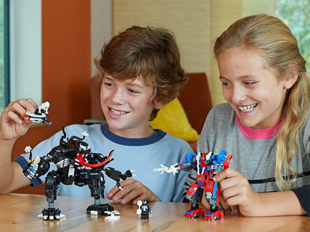 kids playing with Spider-Man Spider Mech vs. Venom