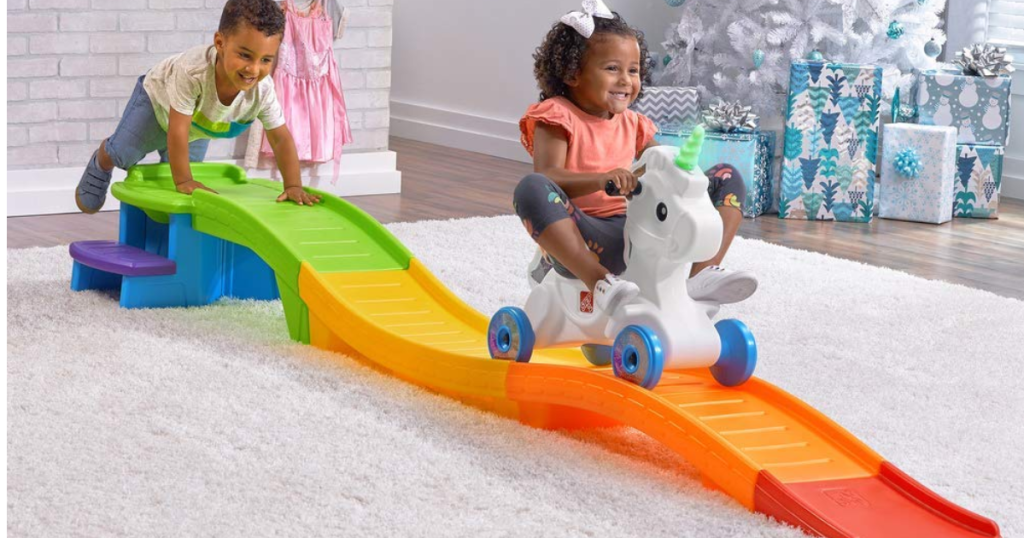 kids playing with ride on track and unicorn