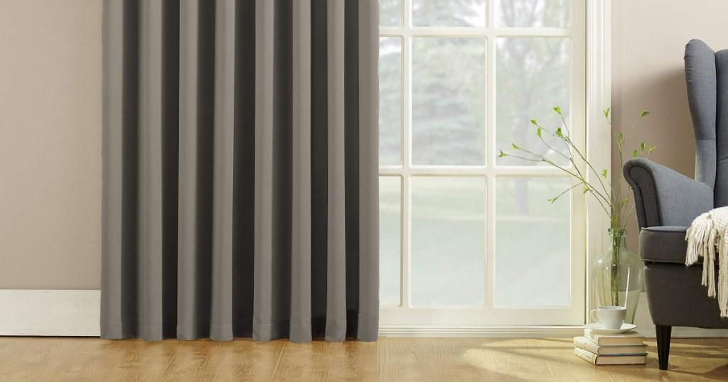 zun zero gray curtain panel hanging in living room
