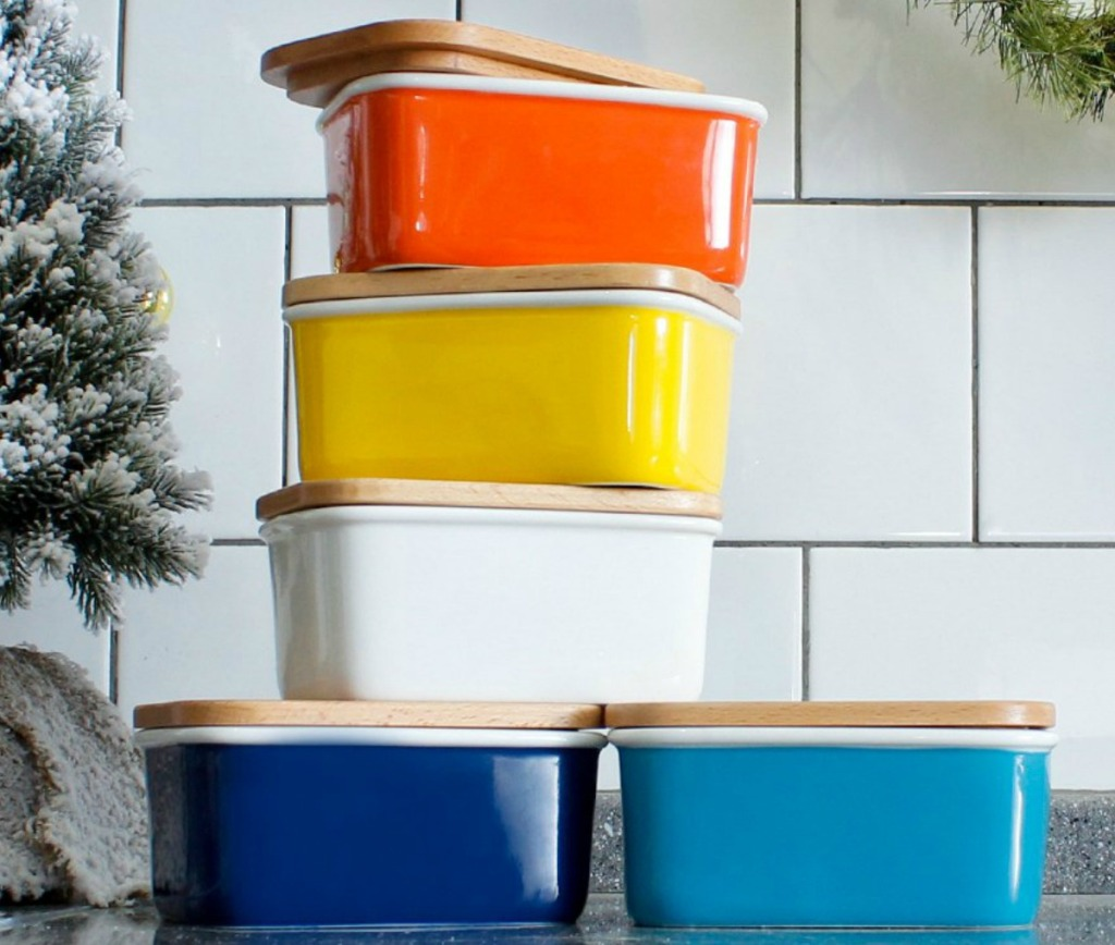 A variety of colors of Sweese Large Porcelain Butter Dish near holiday decor