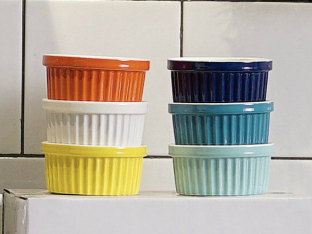 Sweese Porcelain Souffle Ramekins in a variety of colors, stacked on a counter top