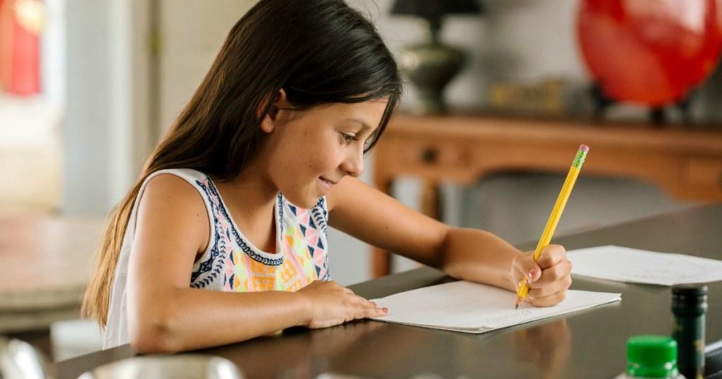 girl using a Ticonderoga Pencil