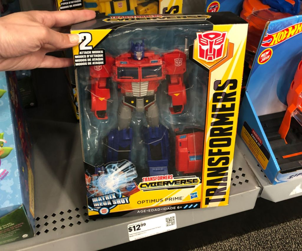 hand holding Transformers cyberverse at best buy