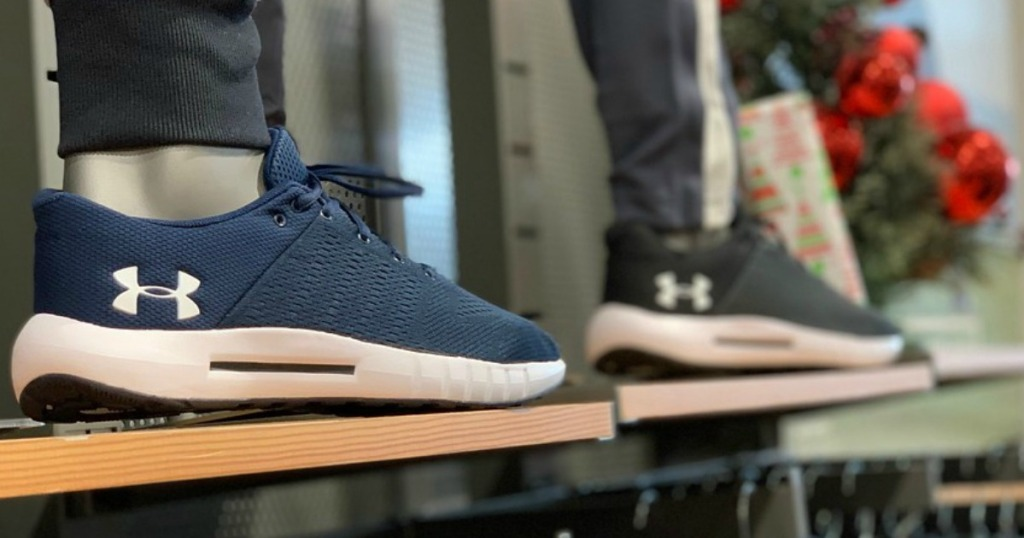 two pairs of under armour sneakers