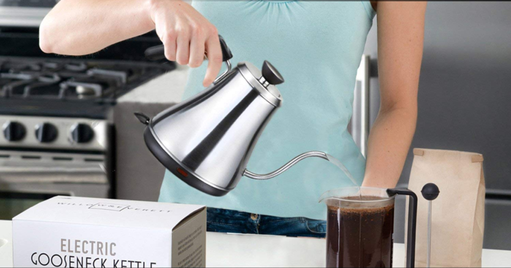 woman pouring kettle in kitchen