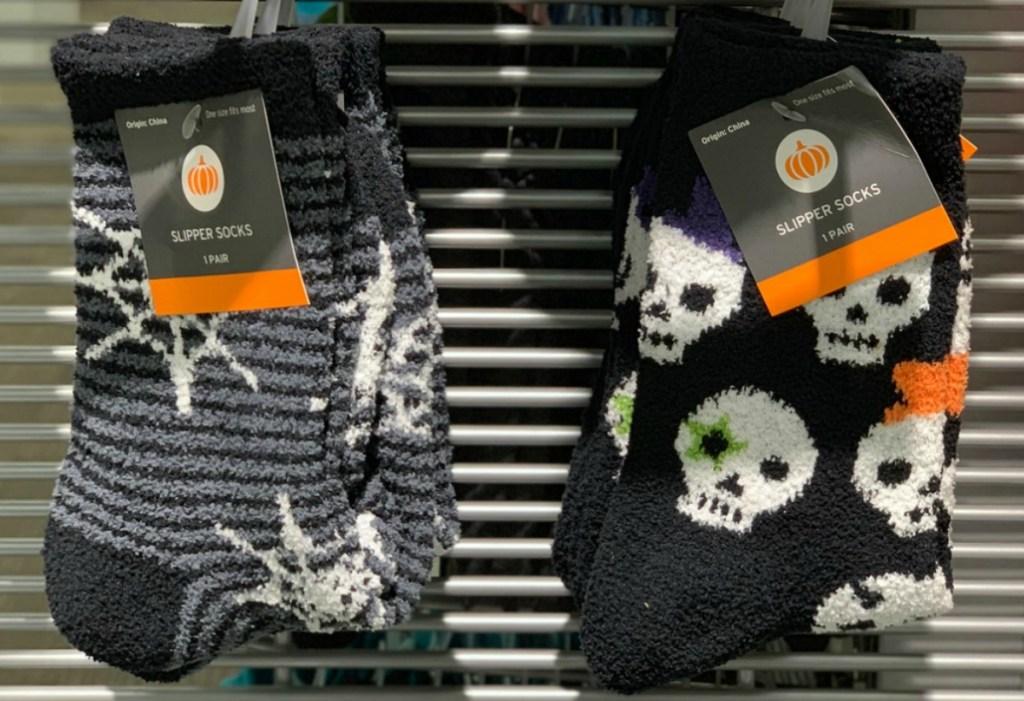 Women's halloween socks with spiderwebs and skulls in store on display