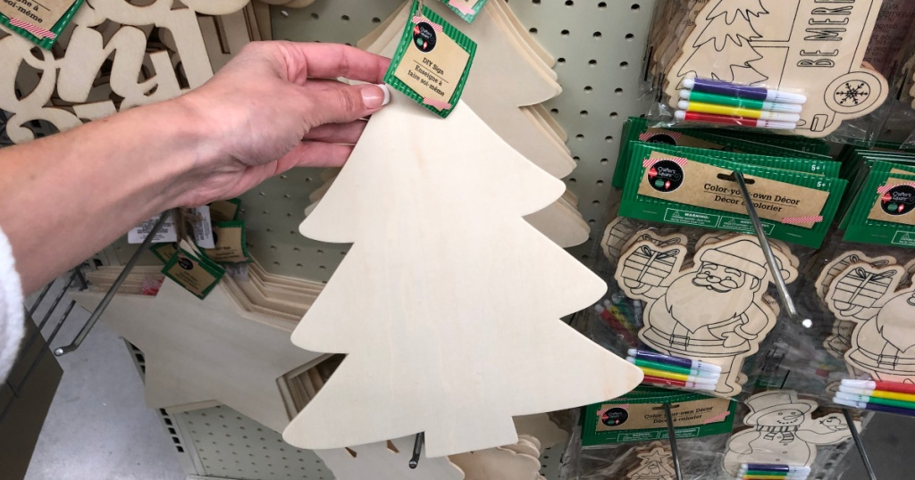 hand holding up wooden christmas tree