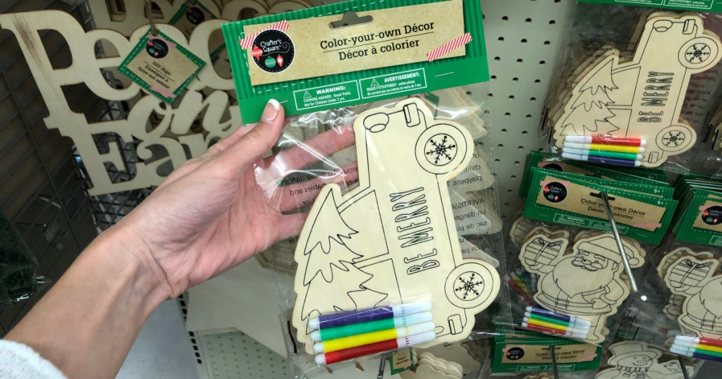 hand holding up wooden color your own decor kit