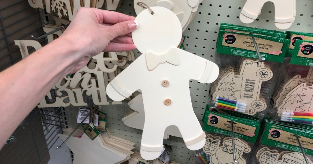 hand holding up wooden gingerbread