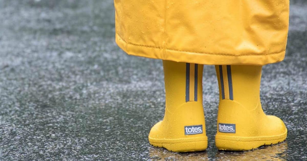 yellow Totes Cirrus Charley Kids Rain Boots worn in rain