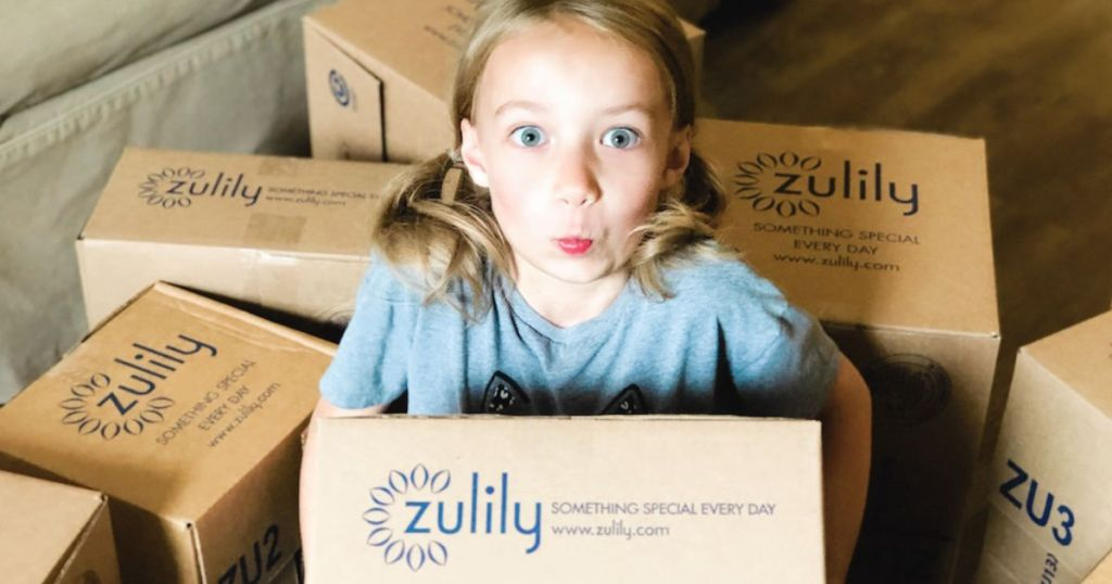 girl holding up zulily box