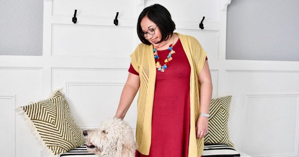 Lina wearing red dress tassel necklace and yellow cardigan