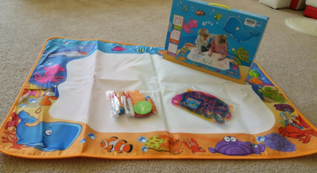 aquadoodle mat on floor with accessories and box