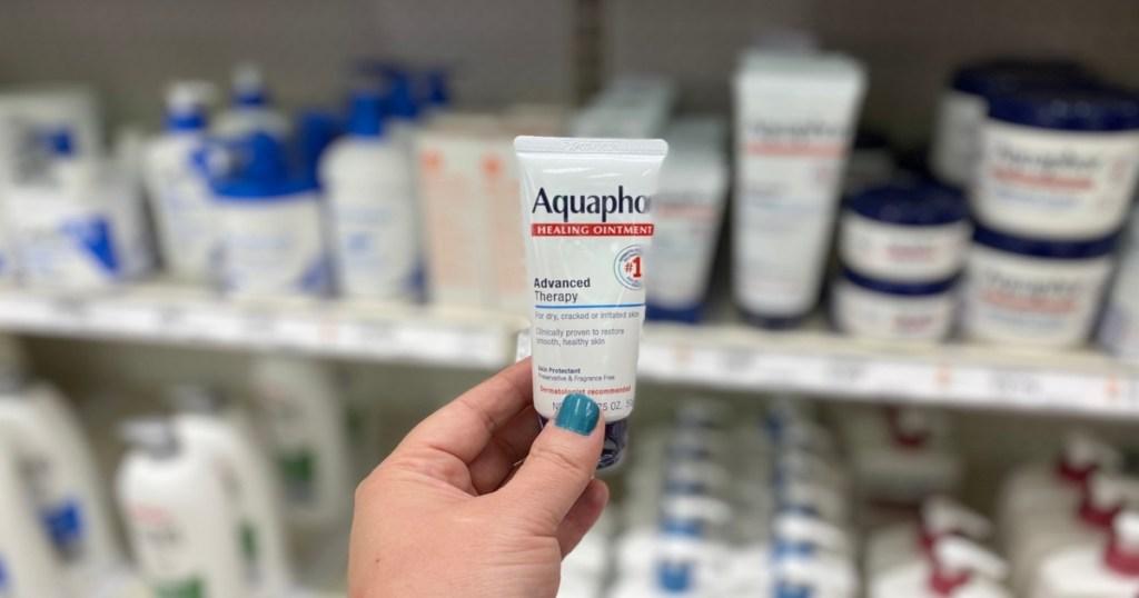 hand holding tube of Aquaphor