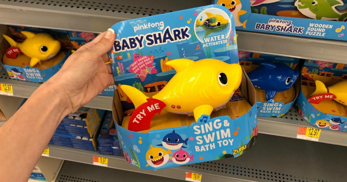 hand holding yellow baby shark
