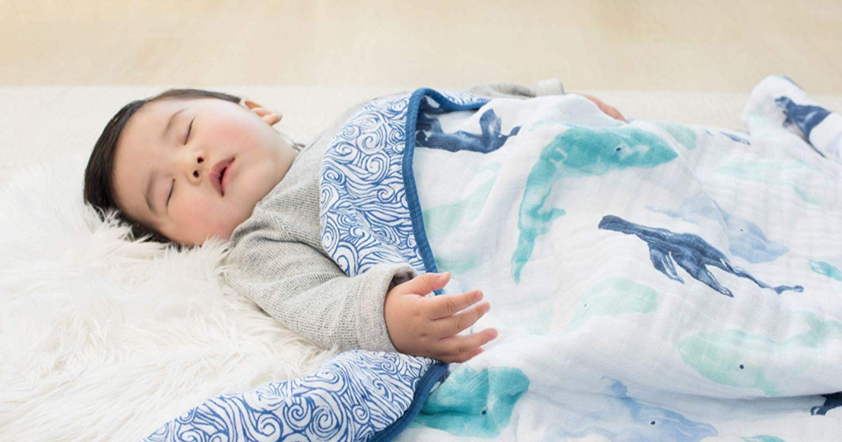 baby sleeping in whale blanket