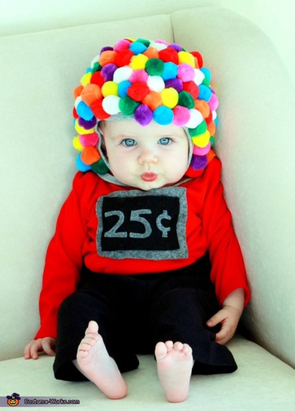 baby wearing 25 cent gumball machine costume