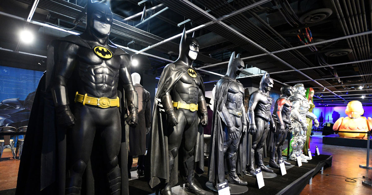 row of batman costumes on display