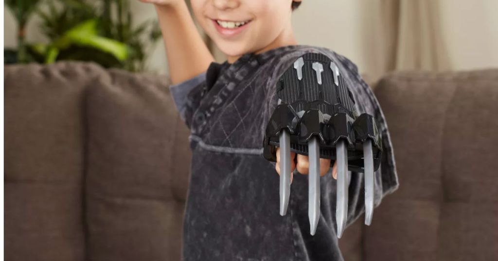 kid showing black panther claw in living room