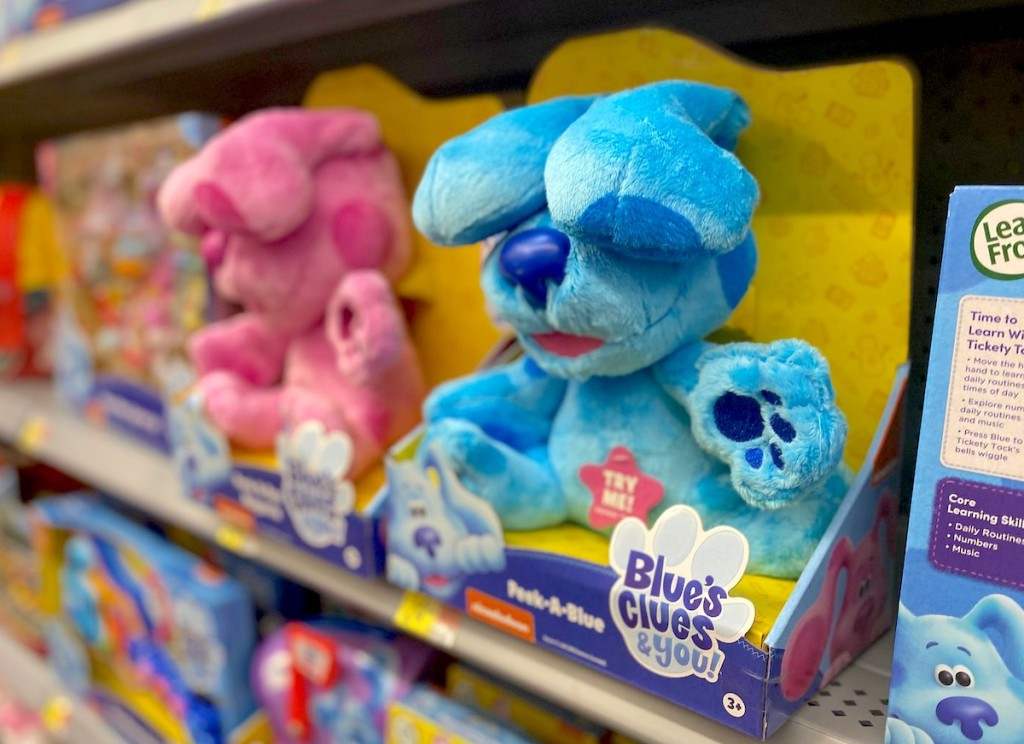 blue and pink blues clues dogs in packaging on store shelf