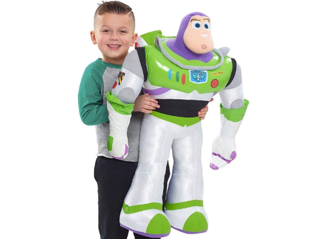 boy holding gigantic disney toy story 4 buzz lightyear plush