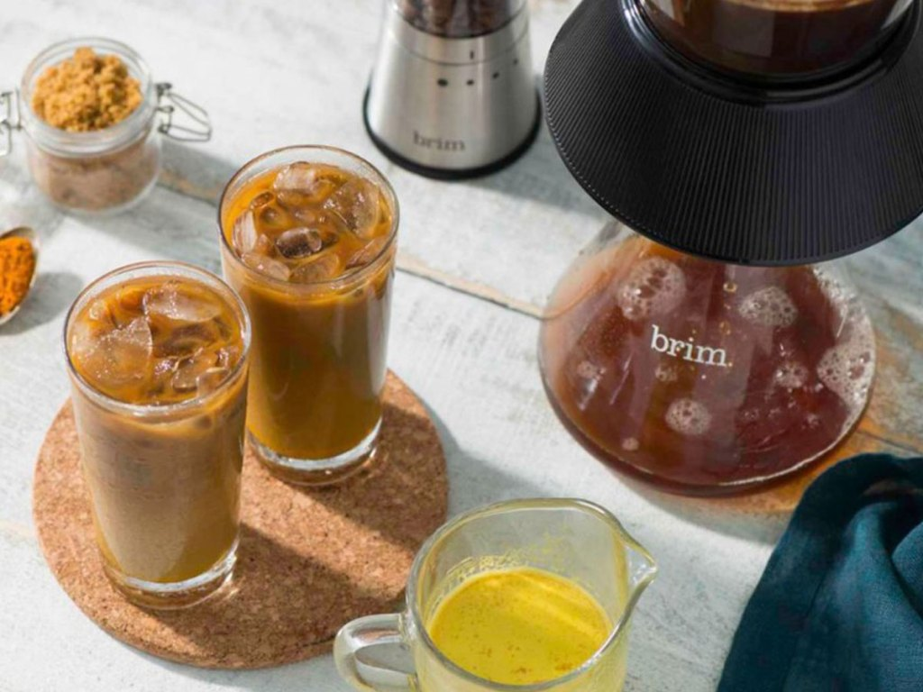 view of brim cold brew coffee maker with two cups of cold coffee