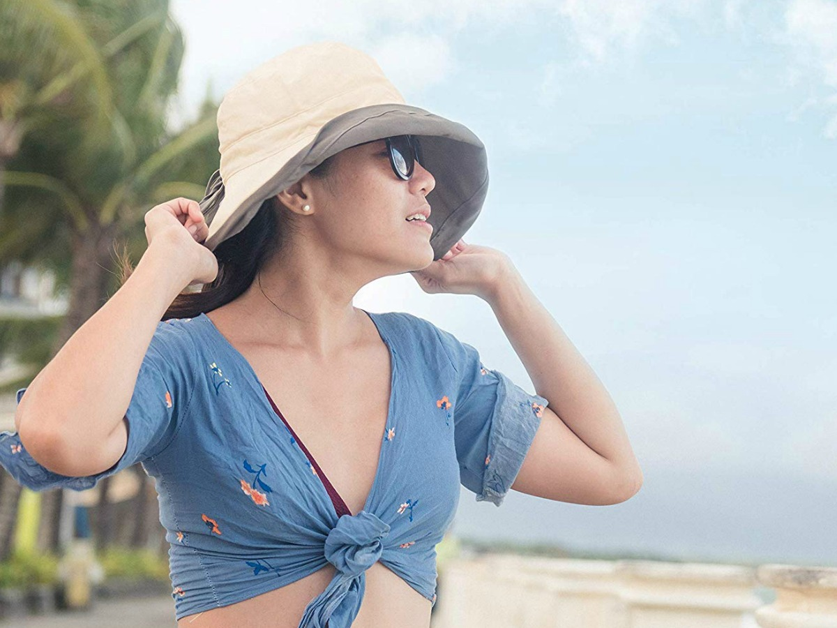 Woman wearing beige sun hat at the beach