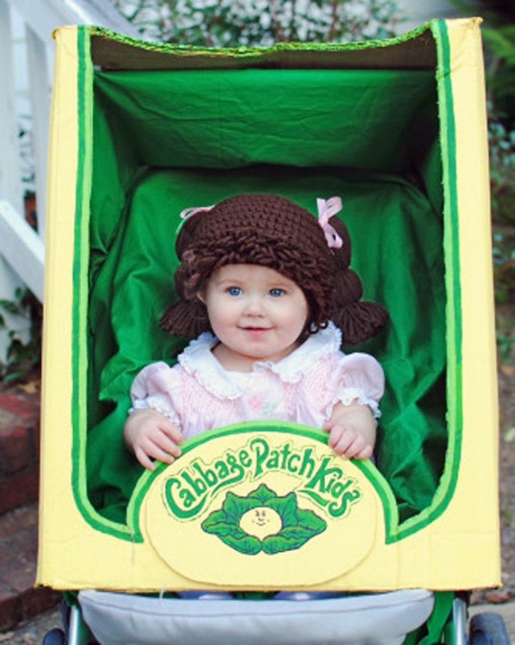 baby wearing cabbage patch doll costume in stroller