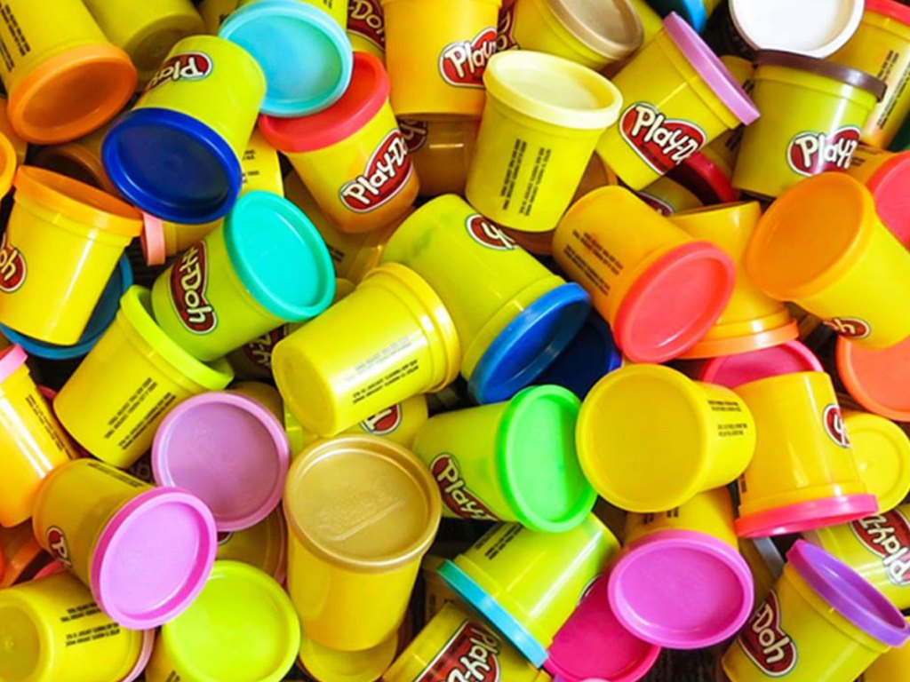 multiple cans of Play-Doh