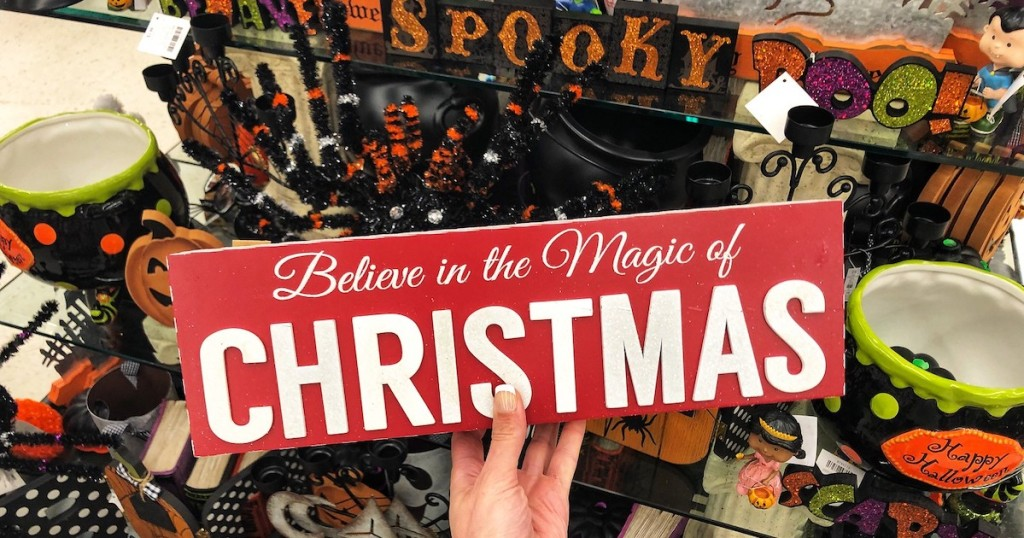 red believe in the magic of christmas sign with halloween decor
