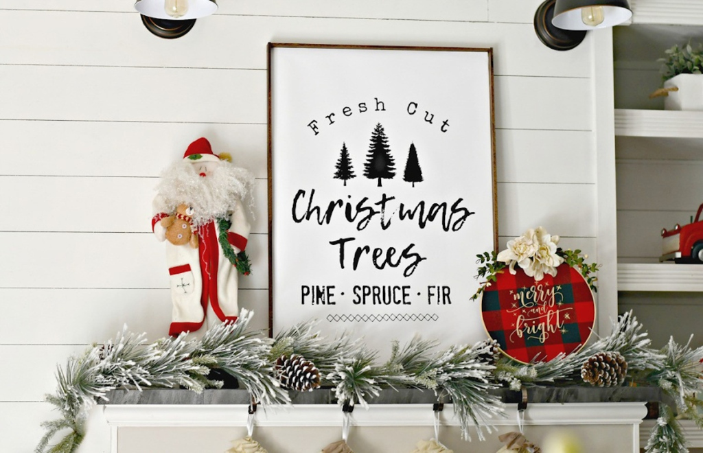 christmas tree wood sign on mantel with nutcracker