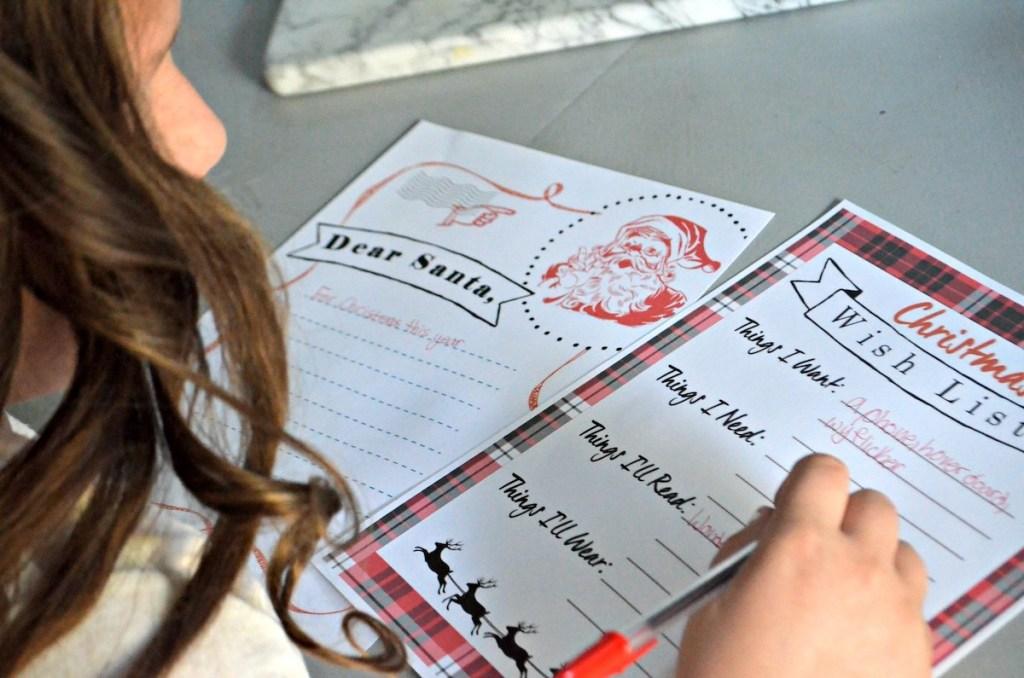 girl writing christmas list