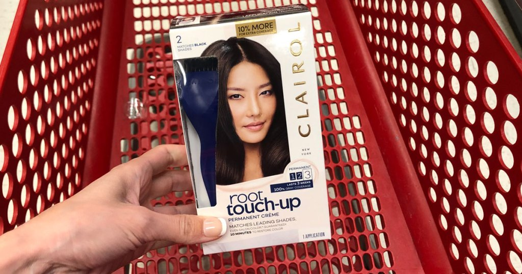 hand holding box of clairol root touch up