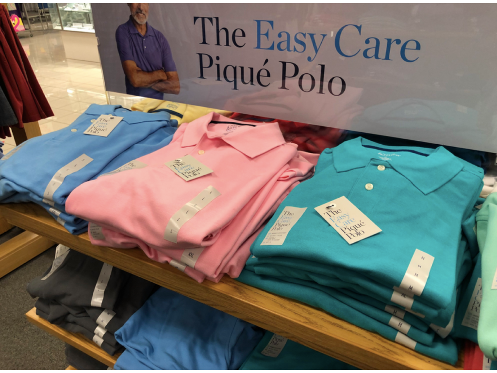 easy care pique polos on store display