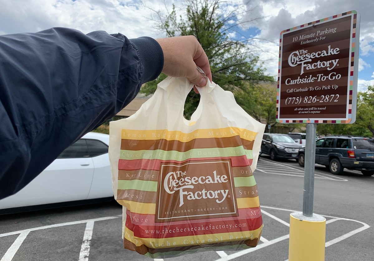 curbside pick up sign with cheesecake factory leftovers bag