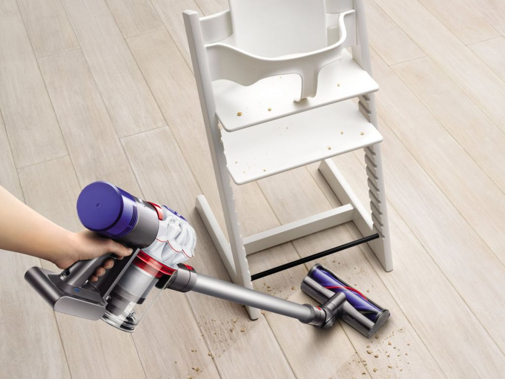 dyson allergy v7 vacuuming around highchair