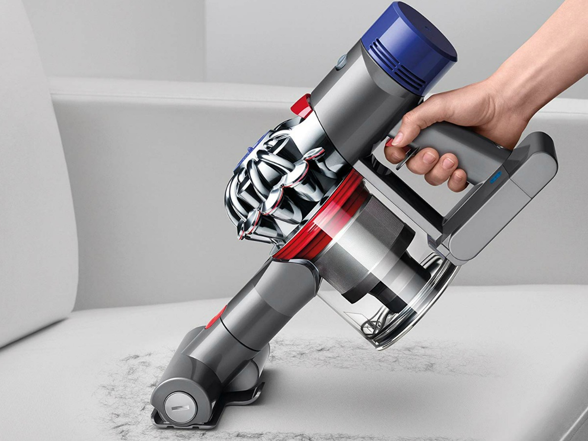 woman using dyson v7 vac