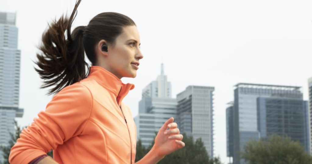 woman wearing Amazon Echo Buds