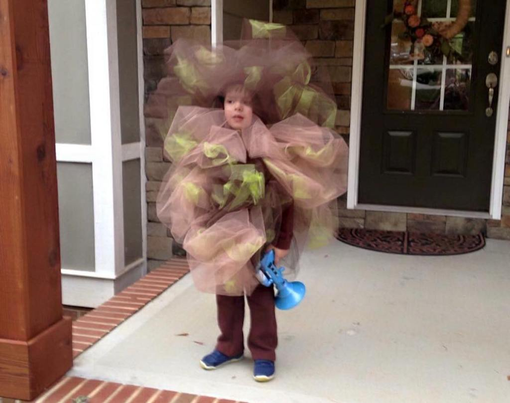 kid wearing fart costume on porch
