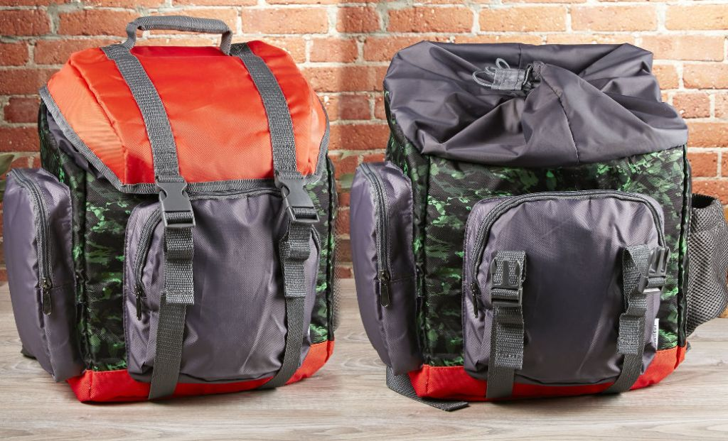 two rucksacks on wood floor with brick wall in background