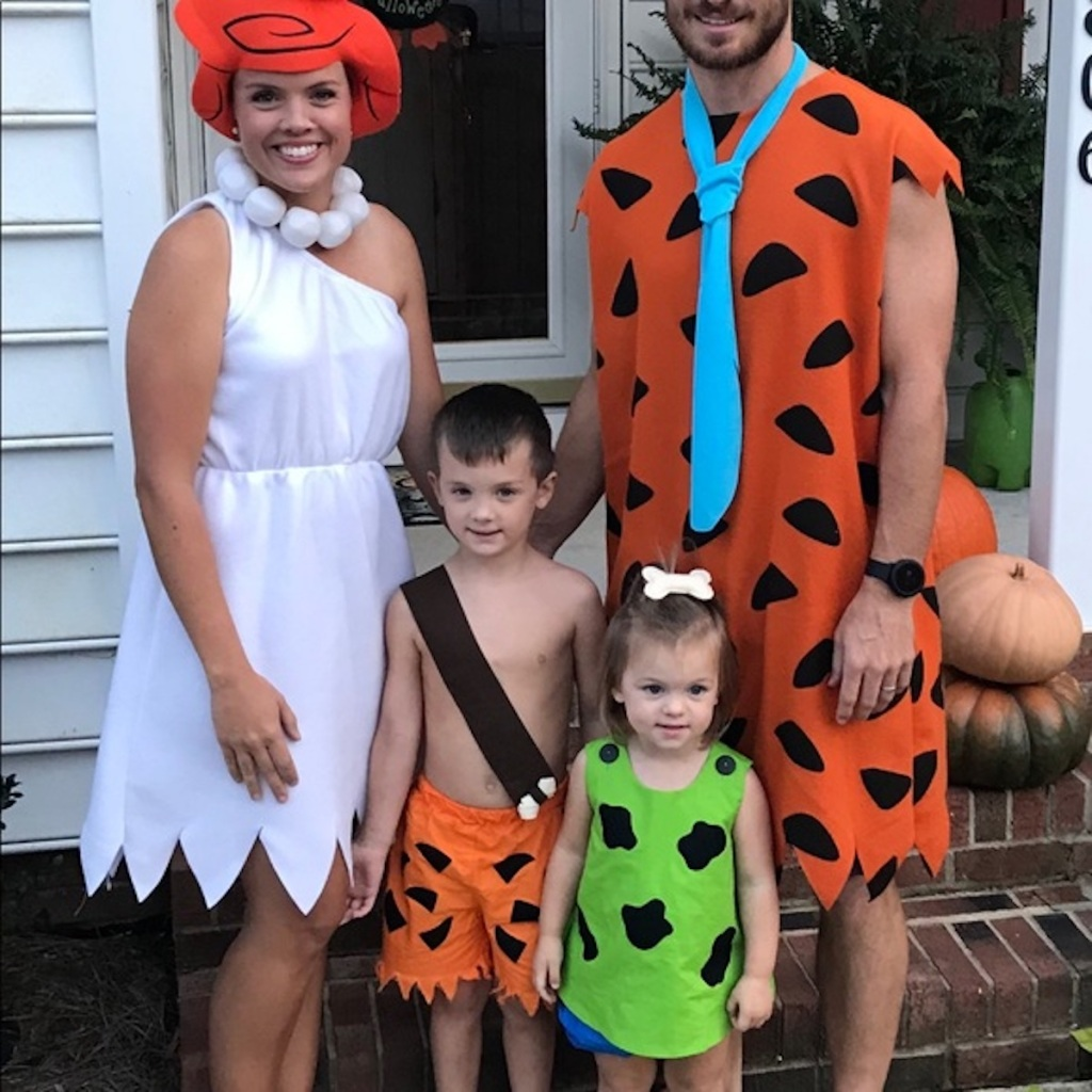 family wearing the flinestones costumes