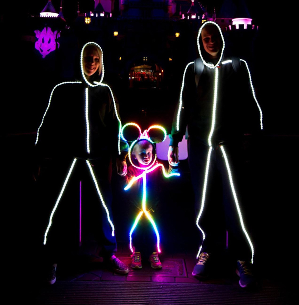 glow stick family wearing costumes