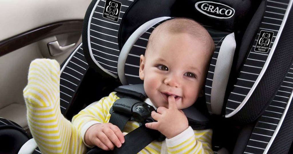 baby smiling in graco 4ever 4 in 1 car seat