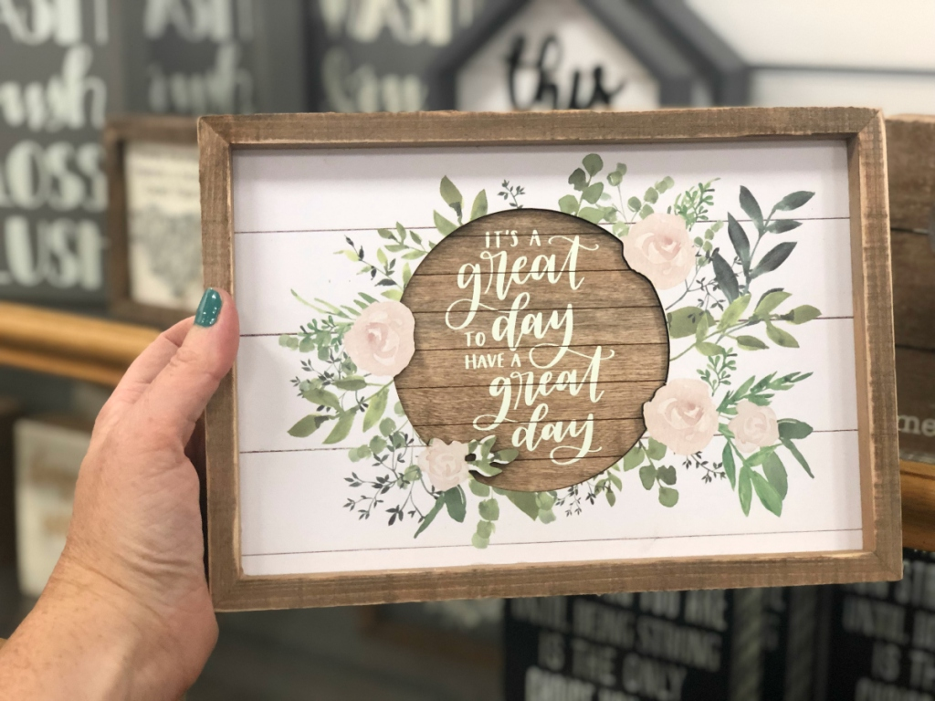 hand holding great day to have a great day farmhouse sign