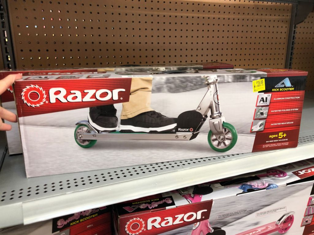 green razor scooter on shelf at walmart