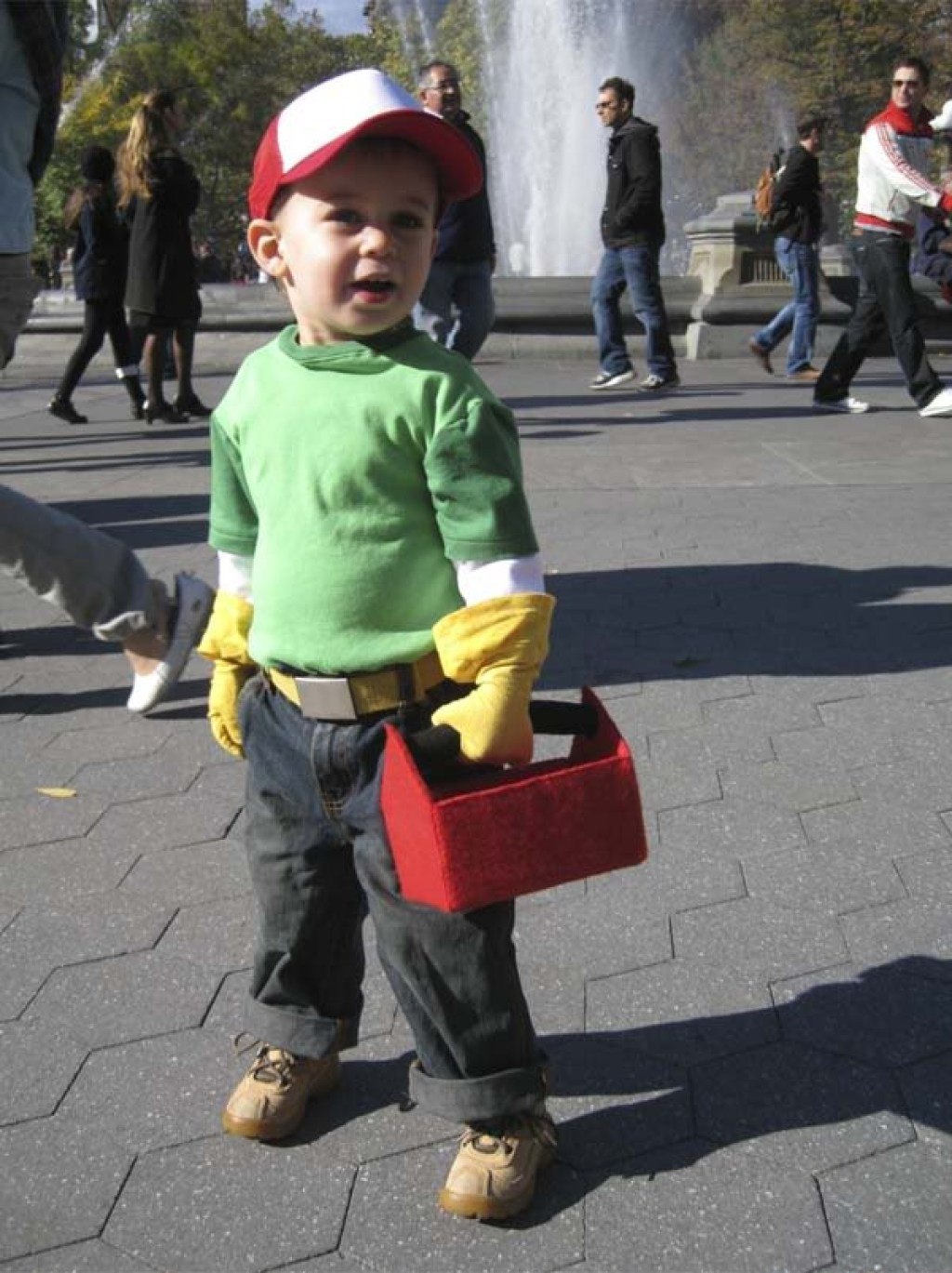 boy wearing handy manny costume