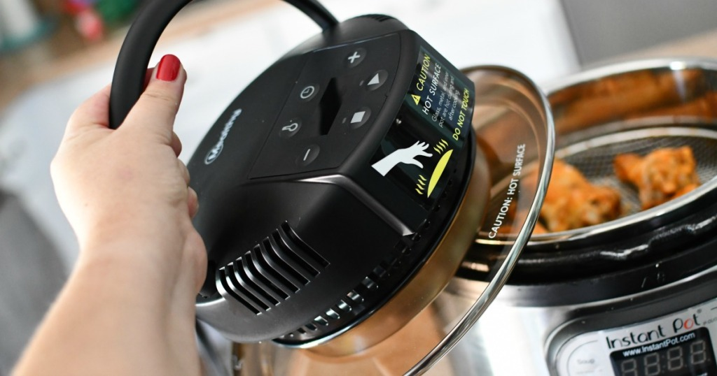 woman removing air fryer lid from Instant Pot