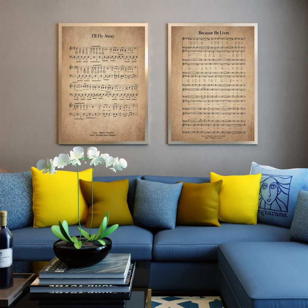 two vintage hymn prints hanging on wall behind couch