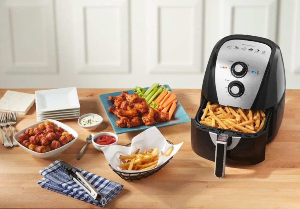 insignia air fryer with cooked food on counter