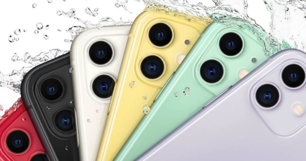 several colors of phone with water splashing on them